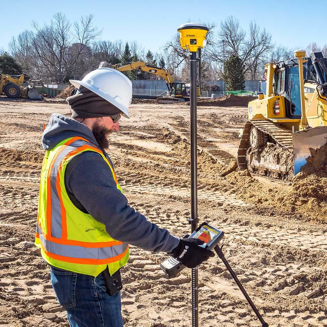 construction surveyor using trimble rover with siteworks
